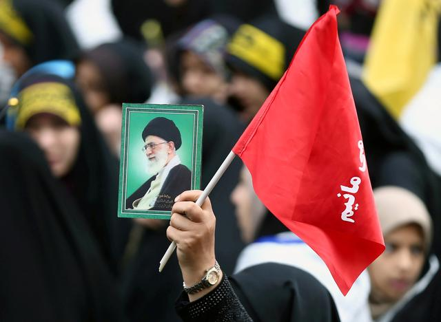 FILE PHOTO: An Iranian protester holds the picture of Iranian Supreme Leader Ayatollah Ali Khamenei as she attends an anti U.S. demonstration, marking the 40th anniversary of the U.S. embassy takeover, near the old U.S. embassy in Tehran, Iran, November 4, 2019. Nazanin Tabatabaee/WANA (West Asia News Agency) via REUTERS/File Photo