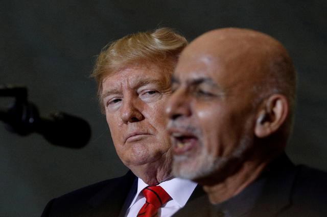 FILE PHOTO: Afghanistan President Ashraf Ghani delivers remarks to U.S. military personnel beside U.S. President Donald Trump during a surprise visit at Bagram Air Base in Afghanistan, November 28, 2019. REUTERS/Tom Brenner/File Photo