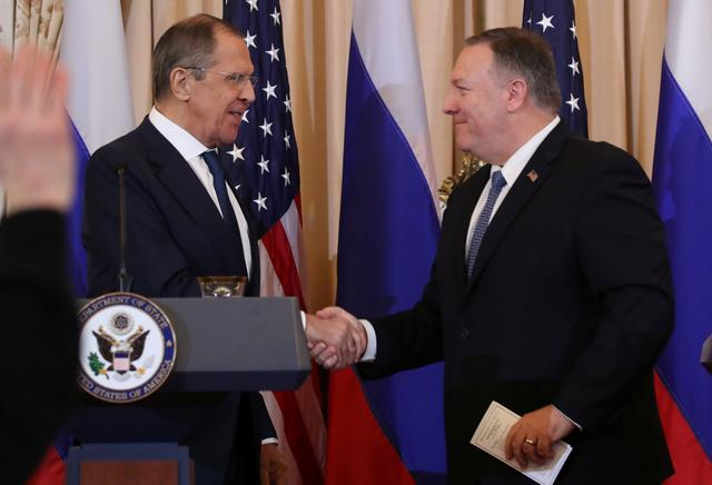 Russia's Foreign Minister Sergey Lavrov and U.S. Secretary of State Mike Pompeo shake hands at the conclusion of a joint news conference at the State Department in Washington, U.S., December 10, 2019. REUTERS/Jonathan Ernst