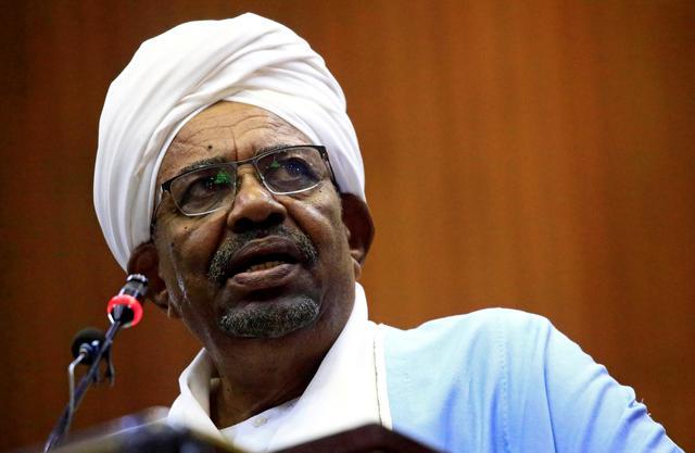 FILE PHOTO: Sudanese President Omar al-Bashir delivers a speech inside Parliament in Khartoum, Sudan April 1, 2019. REUTERS/Mohamed Nureldin Abdallah/File Photo