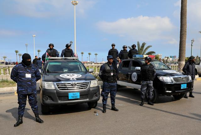 Security forces stand guard during a celebration of the 9th anniversary of the revolution against former Libyan leader Muammar Gaddafi at Martyrs' Square in Tripoli, Libya February 17, 2020. REUTERS/Ismail Zitouny