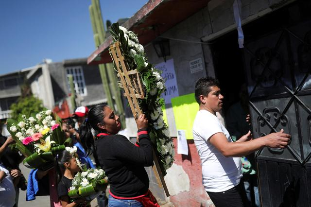 People arrive at the home of seven-year-old Fatima Cecilia Aldrighett, who went missing on February 11 and whose body was discovered over the weekend inside a plastic garbage bag, in Mexico City, Mexico, February 17, 2020. REUTERS/Edgard Garrido