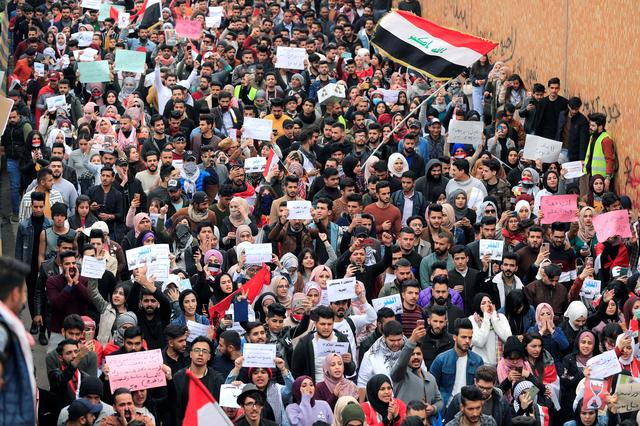 FILE PHOTO: University students gather during ongoing anti-government protests in Baghdad, Iraq February 16, 2020. REUTERS/Thaier al-Sudani