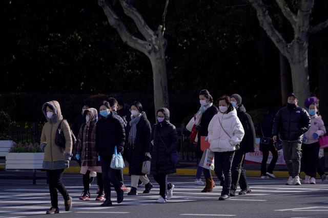 People wear face masks as a protection from coronavirus in the main shopping area, in downtown Shanghai, China February 17, 2020. REUTERS/Aly Song