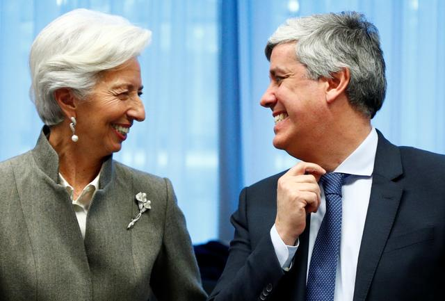 European Central Bank President Christine Lagarde and Portuguese Minister of Finance Mario Centeno react as they attend an Eurozone Finance Ministers meeting in Brussels, Belgium, February 17, 2020. REUTERS/Francois Lenoir