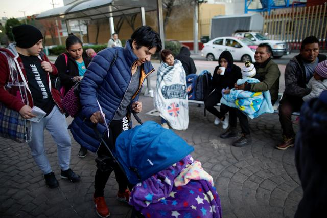 Esperanza Paz pushes the trolley with her son, Hermes Soto, as they wait outside a hospital in Mexico City, Mexico February 17, 2020. REUTERS/Andres Martinez Casares