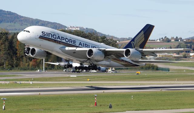 FILE PHOTO: An Airbus A380-800 aircraft of Singapore Airlines takes off from Zurich airport, Switzerland October 16, 2019.  REUTERS/Arnd Wiegmann/File Photo