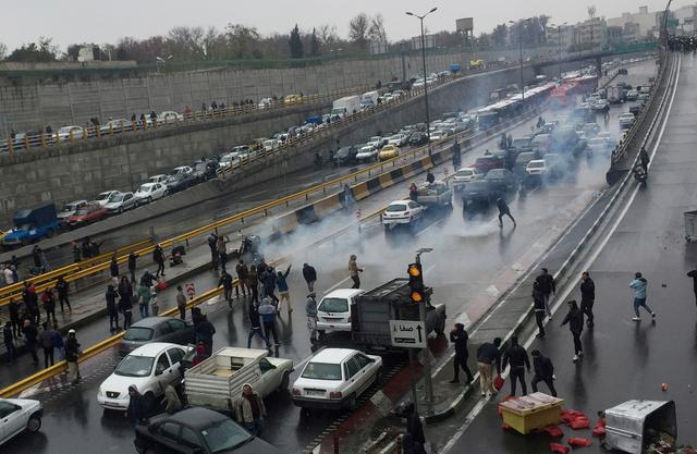 FILE PHOTO: People protest against increased gas price, on a highway in Tehran, Iran November 16, 2019. Nazanin Tabatabaee/WANA (West Asia News Agency) via REUTERS