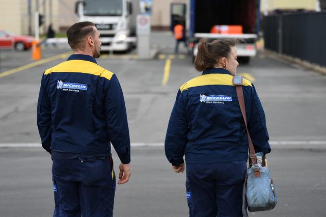 Employees Kristin and Thomas Schmitt walk towards the main gate of the Bamberg branch of French tyre manufacturer Michelin, in Bamberg, Germany, February 13, 2020. REUTERS/Andreas Gebert
