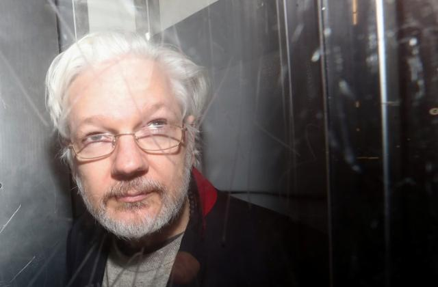 FILE PHOTO: WikiLeaks' founder Julian Assange leaves Westminster Magistrates Court in London, Britain January 13, 2020.  REUTERS/Simon Dawson