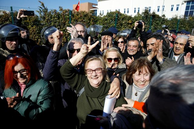 Mucella Yapici, who is one of the 16 defendants acquitted over their alleged role in Turkey's Gezi Park protests case, flashes the V sign while surrounded by her supporters after leaving a courtroom at the Silivri Prison and Courthouse complex in Silivri near Istanbul, Turkey, February 18, 2020. REUTERS/Umit Bektas
