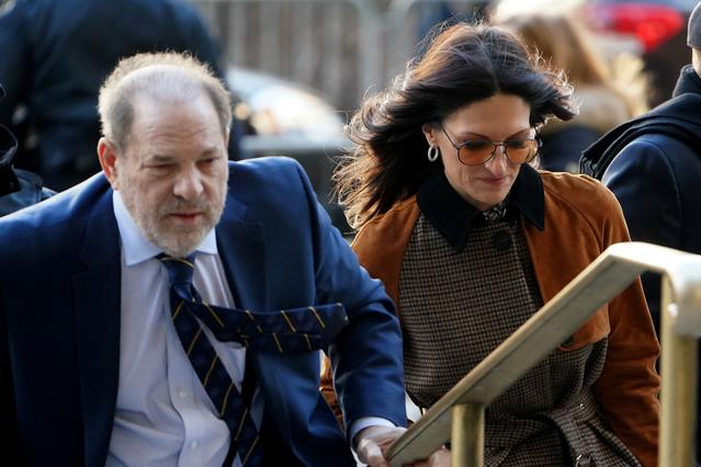 FILE PHOTO: Film producer Harvey Weinstein and attorney Donna Rotunno arrive at New York Criminal Court during his ongoing sexual assault trial in the Manhattan borough of New York City, New York, U.S., February 14, 2020. REUTERS/Carlo Allegri