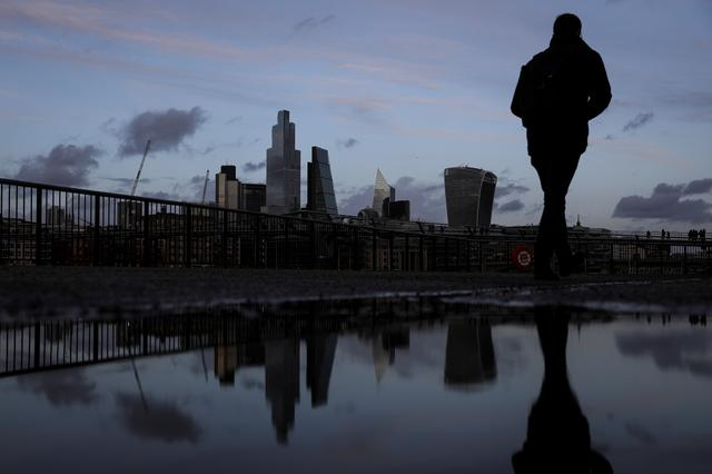 Pedestrians walk along the Southbank in view of skyscrapers in the financial district in London, Britain February 17, 2020. REUTERS/Simon Dawson