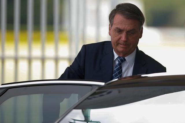 FILE PHOTO: Brazil's President Jair Bolsonaro leaves the Alvorada Palace in Brasilia, Brazil February 4, 2020. REUTERS/Adriano Machado