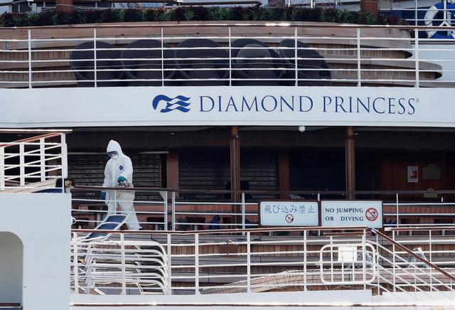 A worker in protective gear is seen on the cruise ship Diamond Princess seen at Daikoku Pier Cruise Terminal in Yokohama, south of Tokyo, Japan February 19, 2020. REUTERS/Kim Kyung-hoon
