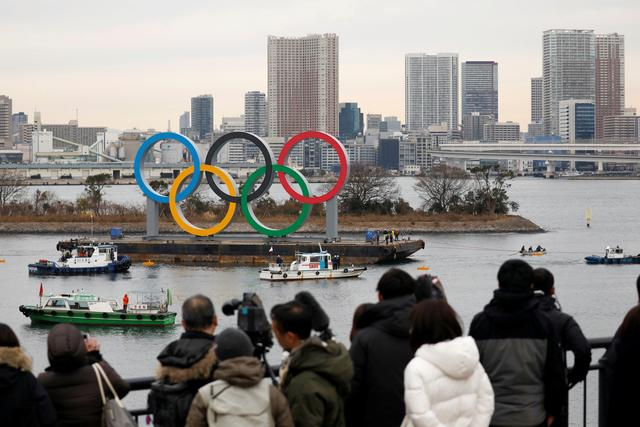 FILE PHOTO: Giant Olympic Rings are installed at the waterfront area, with the Rainbow Bridge in the background,  ahead of an official inauguration ceremony, six months before the opening of the Tokyo 2020 Summer Olympic Games, at Odaiba Marine Park in Tokyo, Japan January 17, 2020. REUTERS/Issei Kato/File Photo