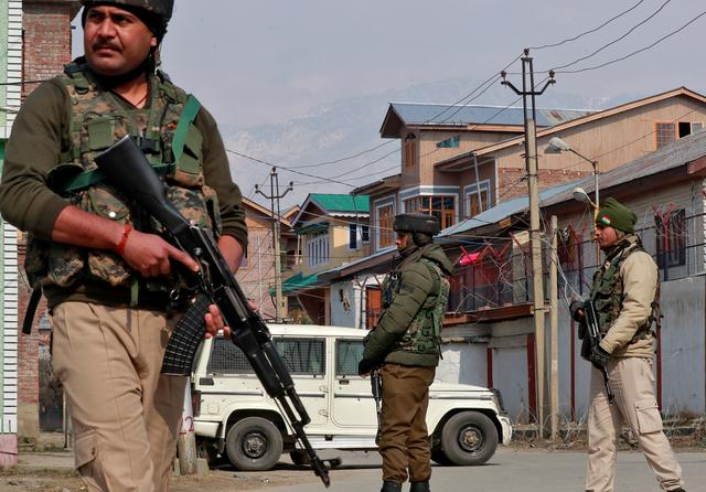 FILE PHOTO: Indian security forces stand guard at the site of a grenade explosion in Srinagar February 6, 2020. REUTERS/Danish Ismail/File Photo