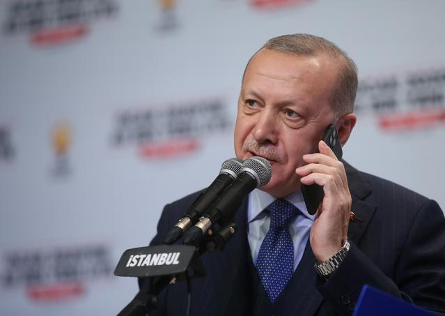 FILE PHOTO: Turkish President Tayyip Erdogan talks to phone as he addresses his ruling AK Party members in Istanbul, Turkey, February 15, 2020. Murat Cetinmuhurdar/Presidential Press Office/Handout via REUTERS THIS IMAGE HAS BEEN SUPPLIED BY A THIRD PARTY.   NO RESALES. NO ARCHIVES
