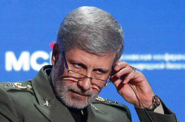 FILE PHOTO: Iranian Defence Minister Amir Hatami adjusts a headphone during the annual Moscow Conference on International Security (MCIS) in Moscow, Russia April 4, 2018. REUTERS/Sergei Karpukhin