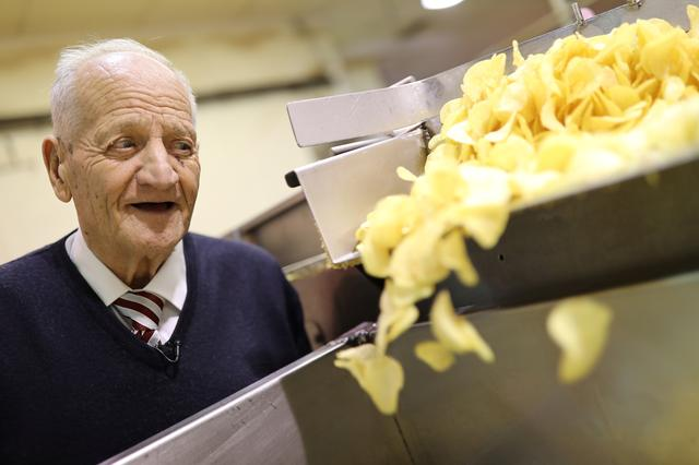 Owner Cesar Bonilla, 87, looks at potato chip production during an interview with Reuters inside his Bonilla a la Vista factory in Arteixo, near Coruna, Spain February 17, 2020. REUTERS/Nacho Doce