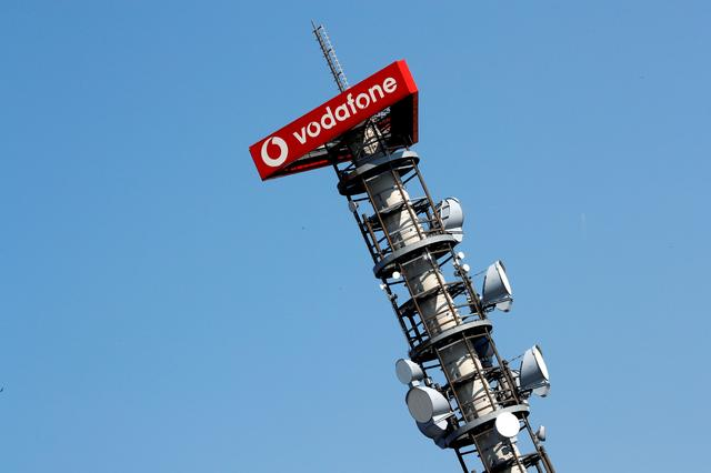 FILE PHOTO: Different types of 4G, 5G and data radio relay antennas for mobile phone networks are pictured on a relay mast operated by Vodafone in Berlin, Germany, April 8, 2019. REUTERS/Fabrizio Bensch/File Photo