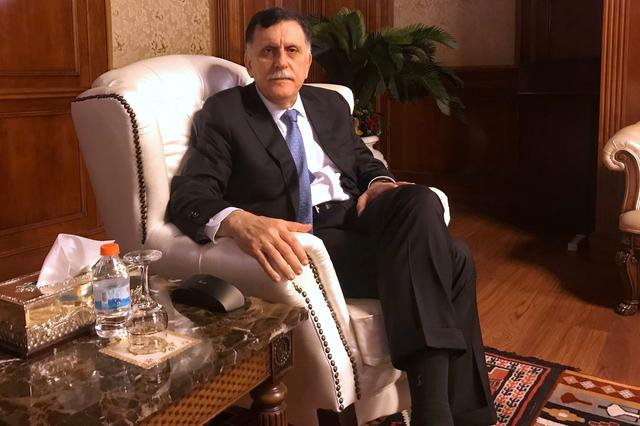 FILE PHOTO: Libya's internationally recognized Prime Minister Fayez al-Serraj is seen during an interview with Reuters at his office in Tripoli, Libya June 16, 2019. Picture taken June 16, 2019. REUTERS/Ulf Laessing