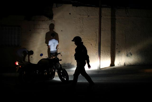 Members of the Special Action Force of the Venezuelan National Police (FAES) stop people during a night patrol, in Barquisimeto, Venezuela September 20, 2019.  REUTERS/Ivan Alvarado