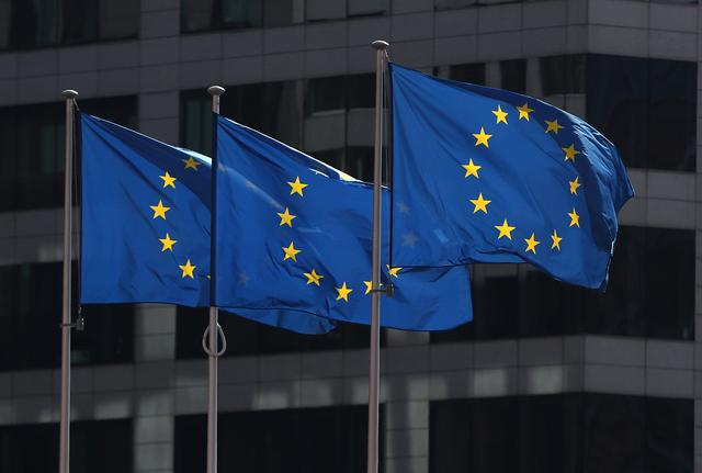 FILE PHOTO: European Union flags fly outside the European Commission headquarters in Brussels, Belgium, April 10, 2019. REUTERS/Yves Herman