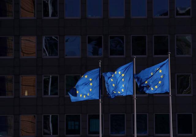 FILE PHOTO: European Union flags fly outside the European Commission headquarters in Brussels, Belgium, February 19, 2020. REUTERS/Yves Herman