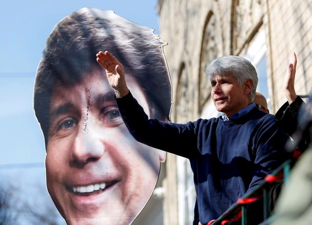 Rod Blagojevich, the ex-Illinois governor convicted of trying to peddle Barack Obama's vacated U.S. Senate seat, waves as he exits his home after speaking to reporters after U.S. President Donald Trump commuted his prison sentence, in Chicago, Illinois, U.S. February 19, 2020.  REUTERS/Joshua Lott