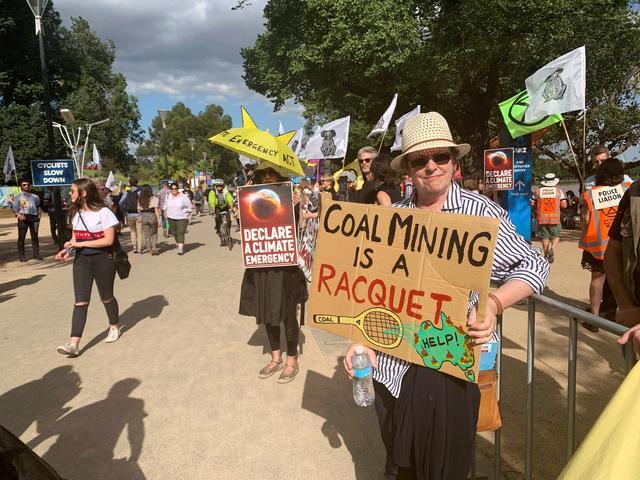 FILE PHOTO: Retired teacher Libby Dougas protests against Australia's lack of action against climate change outside the Australian Open in Melbourne, Australia, January 24, 2020. REUTERS/Melanie Burton