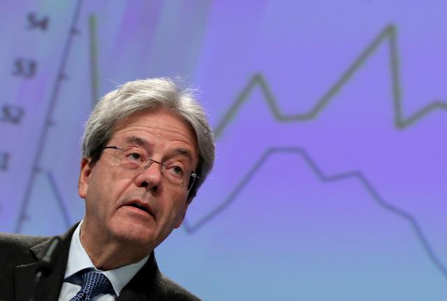 FILE PHOTO: European Economic Commissioner Paolo Gentiloni addresses a news conference on the EU's winter economic forecast, in Brussels Belgium February 13, 2020. REUTERS/Yves Herman