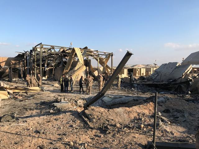FILE PHOTO: U.S. soldiers inspect the site where an Iranian missile hit at Ain al-Asad air base in Anbar province, Iraq January 13, 2020. REUTERS/John Davison
