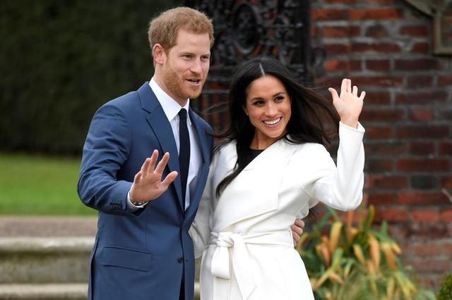 El príncipe Enrique y su esposa Meghan, en Sunken Garden, Kensington Palace, Londres, Reino Unido, 27 noviembre 2017. REUTERS/Toby Melville