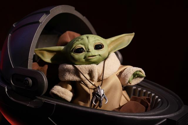 """An animatronic Baby Yoda toy is pictured  during a """"Star Wars"""" advance product showcase in the Manhattan borough of New York City, New York, U.S., February 20, 2020. REUTERS/Carlo Allegri"""