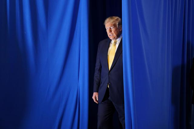 """FILE PHOTO: U.S. President Donald Trump arrives to speak at a """"Hope for Prisoners"""" graduation ceremony at the Metropolitan Police Department headquarters in Las Vegas, Nevada, U.S., February 20, 2020. REUTERS/Kevin Lamarque"""