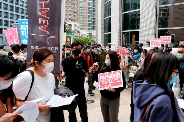 FILE PHOTO: Winnie Yu, chairwoman of the Hospital Authority Employees Alliance (HAEA), speaks during a strike outside the Hospital Authority as they demand for Hong Kong to close its border with China to reduce the coronavirus spreading, in Hong Kong, China February 4, 2020. REUTERS/Tyrone Siu