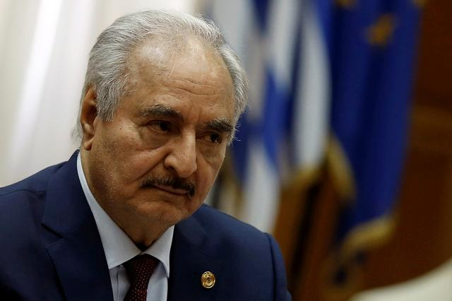 FILE PHOTO: Libyan commander Khalifa Haftar meets Greek Prime Minister Kyriakos Mitsotakis (not pictured) at the Parliament in Athens, Greece, January 17, 2020. REUTERS/Costas Baltas
