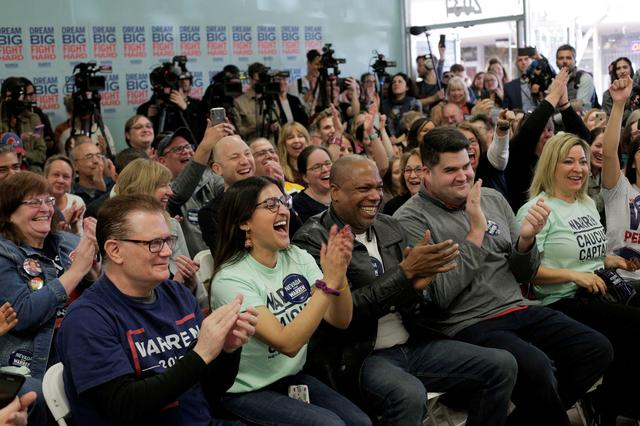 """FILE PHOTO: Supporters laugh as U.S. Democratic presidential candidate Senator Elizabeth Warren holds a """"Canvass Kickoff"""" event at her campaign field office in North Las Vegas, Nevada, U.S. February 20, 2020.   REUTERS/David Ryder"""