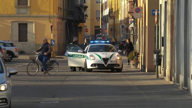 A police car is seen in the village of Codogno after officials told residents to stay home and suspend public activities as 14 cases of coronavirus are confirmed in northern Italy, in this still image taken from video in the province of Lodi, Italy, February 21, 2020. Local Team/REUTERS TV via REUTERS   ATTENTION EDITORS - ITALY OUT. NO COMMERCIAL OR EDITORIAL SALES IN ITALY AND IT WEBSITES.  THIS IMAGE HAS BEEN SUPPLIED BY A THIRD PARTY.