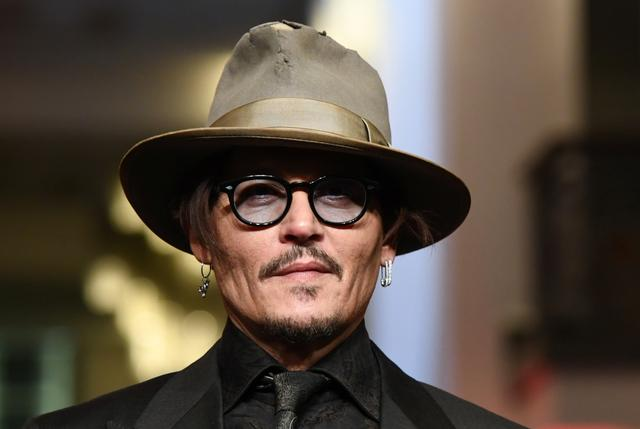 """Actor Johnny Depp arrives for the screening of the movie """"Minamata"""" during the 70th Berlinale International Film Festival in Berlin, Germany, February 21, 2020. REUTERS/Annegret Hilse"""