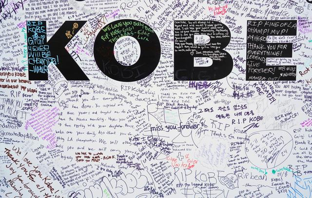 FILE PHOTO: Walls for fans to write tributes to Kobe Bryant  in Microsoft Square near the Staples Center after a helicopter crash killed the retired basketball star, in Los Angeles, California, U.S., January 28, 2020.  REUTERS/Kyle Grillot