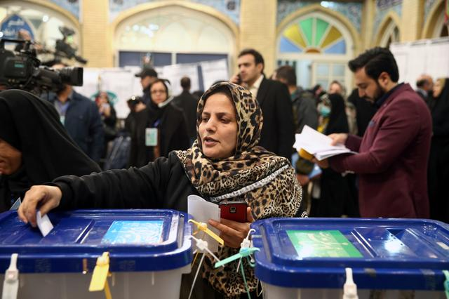 A woman casts her vote during parliamentary elections at a polling station in Tehran, Iran February 21, 2020. Nazanin Tabatabaee/WANA (West Asia News Agency) via REUTERS