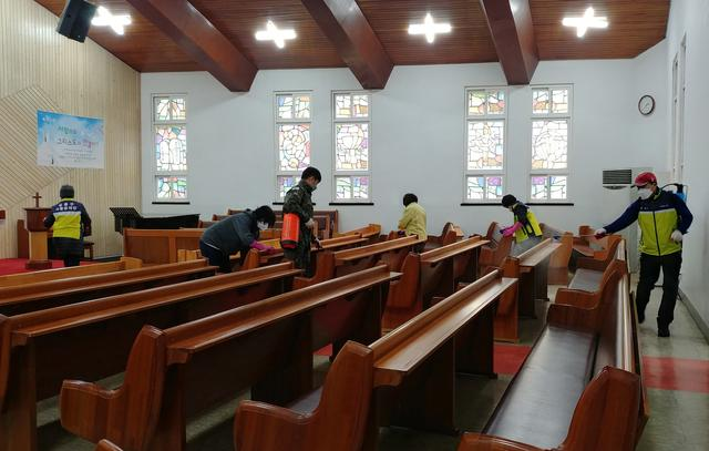 Residents sanitize at a church in Seoul, South Korea, February 22, 2020.  Yonhap via REUTERS