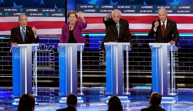 FILE PHOTO: Former New York City Mayor Mike Bloomberg, Senator Elizabeth Warren, Senator Bernie Sanders and former Vice President Joe Biden (L-R) all speak simultaneously at the ninth Democratic 2020 U.S. Presidential candidates debate at the Paris Theater in Las Vegas, Nevada, U.S., February 19, 2020. REUTERS/Mike Blake -/File Photo
