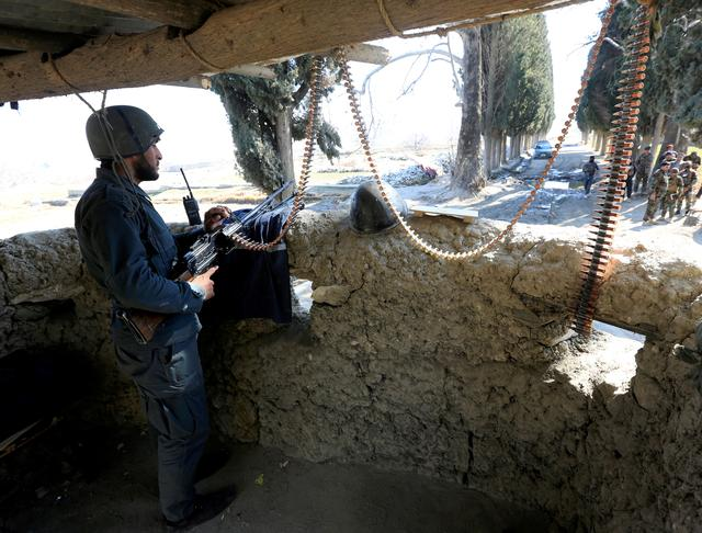 FILE PHOTO: An Afghan security force member stands guard at a security tower where two U.S soldiers were killed a day before in Shirzad district of Nangarhar province, Afghanistan February 9, 2020. REUTERS/Parwiz/File Photo