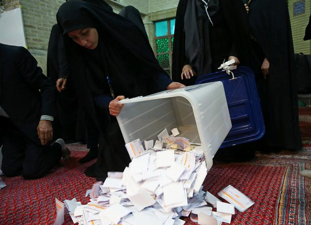 Poll workers empty full ballot boxes after the parliamentary election voting time ended in Tehran, Iran February 22, 2020. Nazanin Tabatabaee/ WANA (West Asia News Agency)/Nazanin Tabatabaee via REUTERS