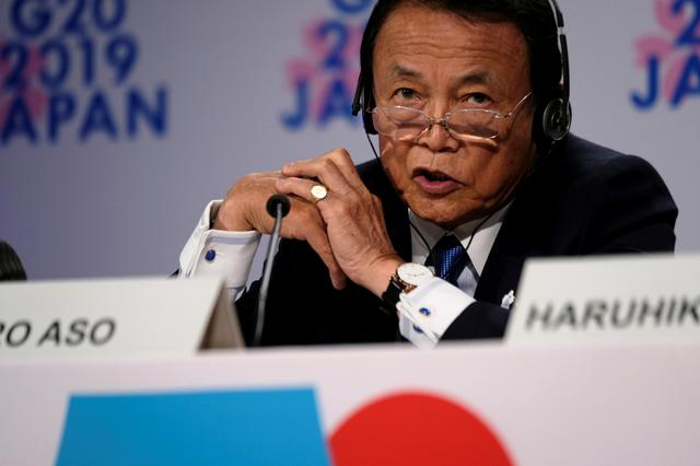 FILE PHOTO: Japanese Finance Minister Taro Aso takes questions from reporters at the annual meetings of the International Monetary Fund and World Bank in Washington, U.S., October 18, 2019. REUTERS/James Lawler Duggan