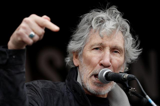 Singer Roger Waters speaks during a protest against the extradition of Julian Assange, at the Parliament Square in London, Britain, February 22, 2020. REUTERS/Peter Nicholls
