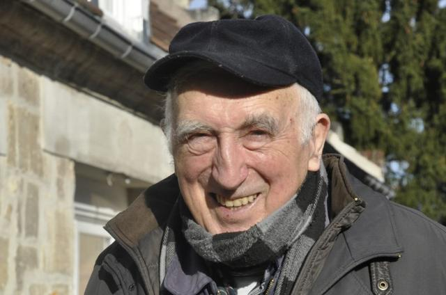 FILE PHOTO: Jean Vanier, poses outside his home in Trosly-Breuil, in this picture taken March 7, 2015.     REUTERS/Tom Heneghan